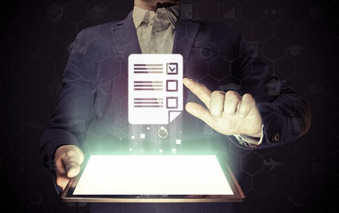 help your seo image of a man wearing a suit holding a tablet computer displaying a checklist graphic
